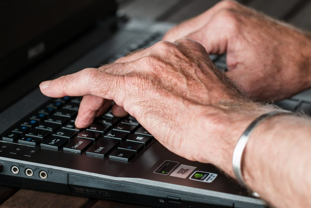 Older person using laptop at home